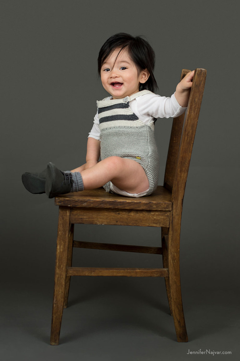 Baby Boy Sitting in a Wooden Chair