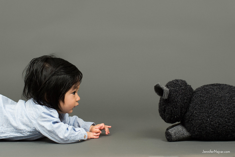 Unique Photo of Baby Boy Face to Face with a Stuffed Animal